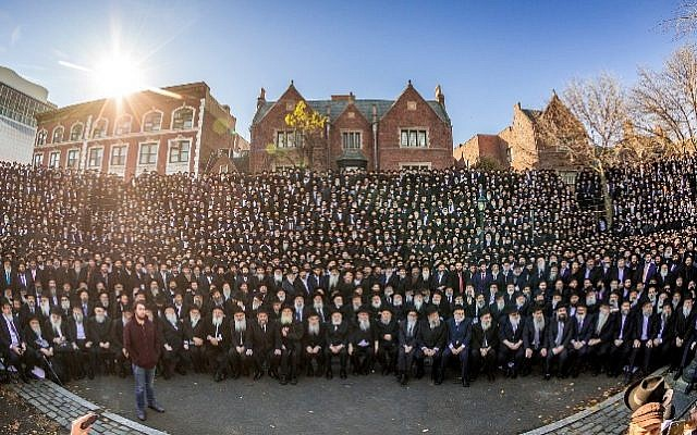 Some 4,700 Chabad-Lubavitch emissaries from 100 countries pose for the annual group photo in front of the organization's Brooklyn headquarters. (Courtesy)