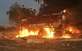 A bus burns after it was hit by an anti-tank missile fired from the Gaza Strip near the Israel-Gaza border on November 12, 2018. (Israel Defense Forces/Twitter)