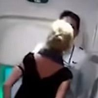 Screen capture from video of rights activist and international lawyer Simone O'Broin during an altercation on an Air India flight. (YouTube)
