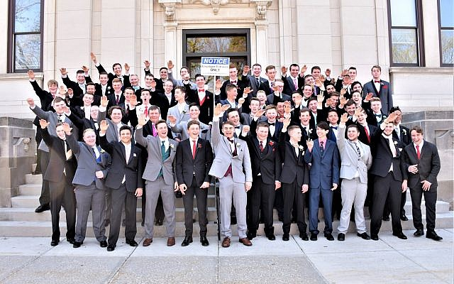 A group of high school students in Baraboo, Wisconsin, making a salute in a photo published on November 11, 2018. At back right is Jordan Blue, who didn't salute. (Screenshot: Twitter)