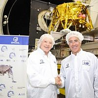Canadian real estate mogul Sylvan Adams, right, with Morris Kahn, at Israel Aerospace Industries (IAI)'s MBT Space facility in Yehud where SpaceIL's spacecraft to the moon is being assembled (Eliran Avital)
