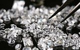 Illustration of diamonds being picked by  jewelry maker in Jerusalem, July 21, 2008. (Nati Shohat/Flash90)