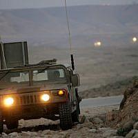 Illustrative: An Israeli military jeep patrols along the border with Egypt on March 29, 2005. (Moshe Shai/FLASH90)