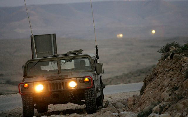Illustrative: An Israeli military jeep patrols along the border with Egypt on March 29, 2005. (Moshe Shai/FLASH90)