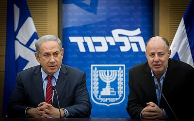 Prime Minister Benjamin Netanyahu (L) and Tzachi Hanegbi at a Likud party faction meeting at the Knesset in Jerusalem on February 22, 2016. (Miriam Alsterl/Flash90)