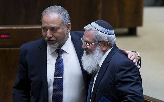 Eli Ben-Dahan of the Jewish Party and Yisrael Beytenu leader Avigdor Lieberman at the Knesset on June 1, 2016. (Yonatan Sindel/Flash90)