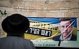 An ultra-Orthodox man stands outside a campaign office for Jerusalem mayoral candidate Ofer Berkovitch in Jerusalem on November 8, 2018. (Hadas Parush/Flash90)