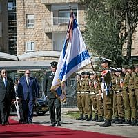 Incoming Jordanian Ambassador to Israel Ghassan Majali inspects an honor guard during a ceremony for new ambassadors at the President's Residence in Jerusalem, November 8, 2018. (Yonatan Sindel/Flash90)
