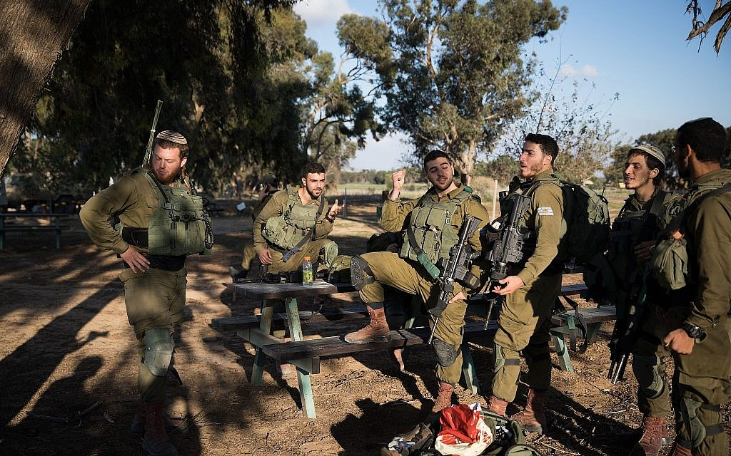 IDF soldiers rest close to Kibbutz Nir Oz, in southern Israel near the border with Gaza, on November 12, 2018. (Hadas Parush/Flash90)