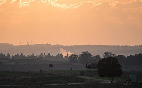 Illustrative: Smoke rises from a fallen rocket fired from Gaza in a field in southern Israel near the border with Gaza on November 13, 2018. (Hadas Parush/Flash90)