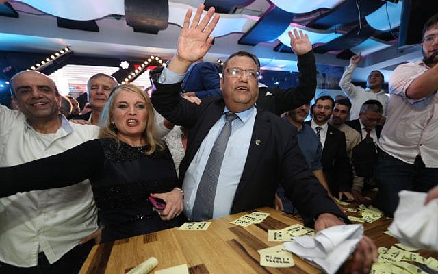 Supporters of Jerusalem mayoral candidate Moshe Lion (center) react as the preliminary results of the mayoral race are announced, November 13, 2018. (Yonatan Sindel/FLASH90)