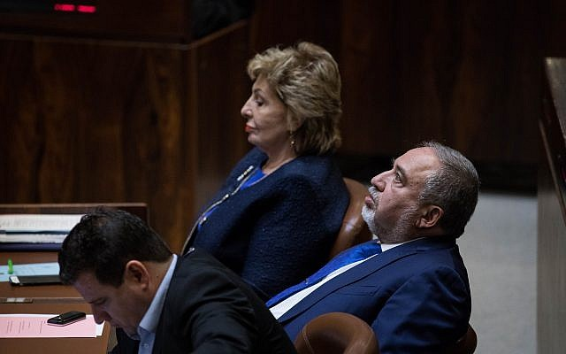Recently resigned former defense minister Avigdor Liberman sits with oppositino lawmakers during a Knesset meeting November 19, 2018. (Hadas Parush/Flash90)