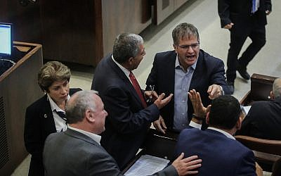 A scuffle between Knesset members, at a plenum session at the Israeli parliament on November 19, 2018. (Hadas Parush/Flash90)
