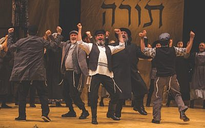 "Steven Skybell (Tevye), center, and ensemble in National Yiddish Theatre Folksbiene's Production of ""Fiddler on the Roof."" (Victor Nechay/ProperPix via JTA)"
