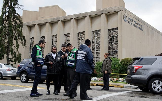 A Jewish emergency crew and police officers at the site of the mass shooting that killed 11 people and wounded 6 at the Tree Of Life Synagogue on October 28, 2018 in Pittsburgh, Pennsylvania. (Jeff Swensen/Getty Images/via JTA)