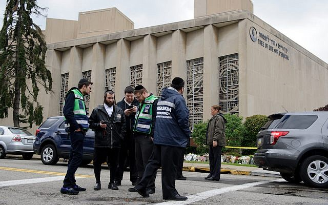A Jewish emergency crew and police officers at the site of the mass shooting that killed 11 people and wounded 6, including 4 police, at the Tree of Life Synagogue on October 28, 2018, in Pittsburgh, Pennsylvania. (Jeff Swensen/Getty Images/via JTA)