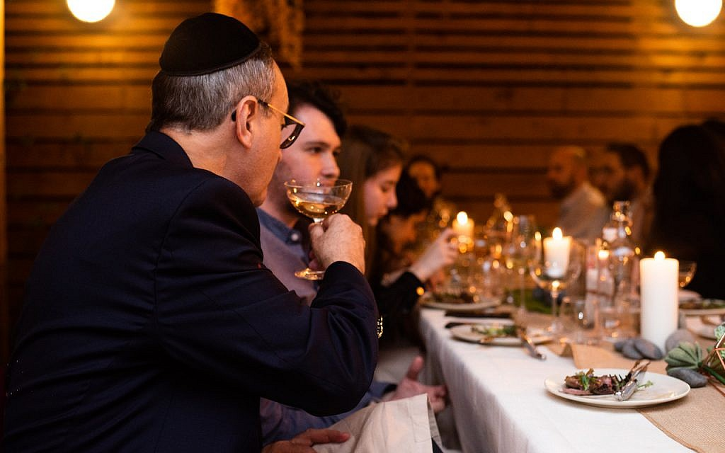 Guests enjoy dinner at the Musket Club. (Hanoch Melamed Cohen)