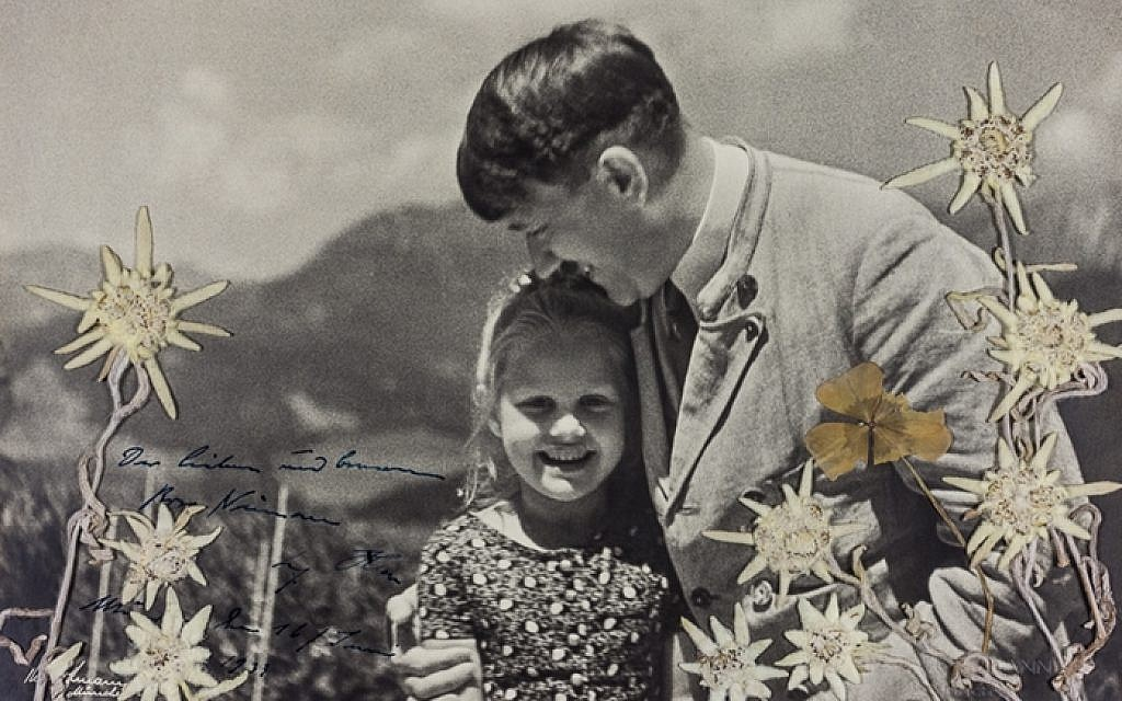 Up for auction: Photo of Hitler embracing young girl he knew was Jewish