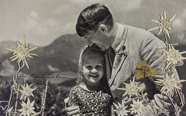 A photograph of Adolf Hitler together with Rosa Bernile Nienau, a Jewish girl, taken at Hitler's home, the Berghof, in the Bavarian Alps, April 20, 1932. (Alexander Historical Auctions)