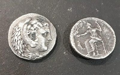 Two coins imprinted between 323 and 325 BCE, during the last years of Alexander the Great's reign, found in a smuggler's luggage at the Erez Crossing on the Israel-Gaza border on November 7, 2018. (Courtesy Defense Ministry/COGAT)