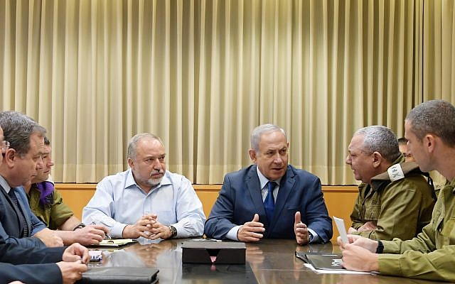 Prime Minister Netanyahu and then- Defense Minister Avigdor Liberman speak with IDF Chief of Staff Gadi Eizenkot at the IDF headquarters in Tel Aviv on November 12, 2018. (Amos Ben Gershom)