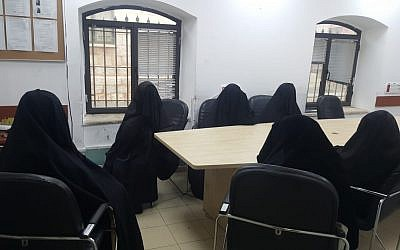 Two women and four minors are seen at a police station after being detained in a raid on an underage wedding in the ultra-Orthodox Mea Shearim neighborhood of Jerusalem, on November 29, 2018. (Israel Police)