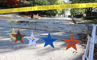 Stars hanging in the Squirrel Hill neighborhood of Pittsburgh painted by children from a Manhattan synagogue as part of the Stars of Hope initiative. (Hane Grace Yagel via JTA)