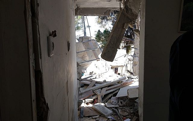 The scene inside an Ashkelon apartment where a man was killed by a rocket fired from the Gaza Strip which hit the building, November 13, 2018. (The Times of Israel)