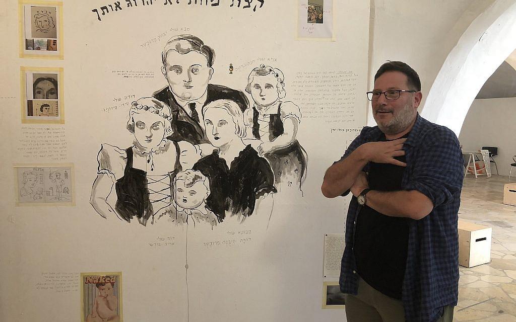 Artist Itzik Rennert draws on family memories that aren't always sweet, at Illustration Week 2018 (Jessica Steinberg/Times of Israel)