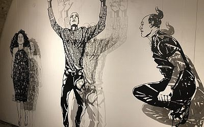 Michal Bachar's laser-cut figurines, creating shadow profiles in black and white, at Illustration Week 2018 (Jessica Steinberg/Times of Israel)