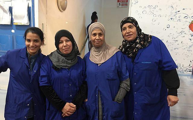 Sharona Apterkar, left to right, Rahma-Al-Turi, Amna-Abu-Adayan and another worker at the Idan HaNegev site of SodaStream; Nov. 15, 2018; (Federico Maccioni/TimesofIsrael)