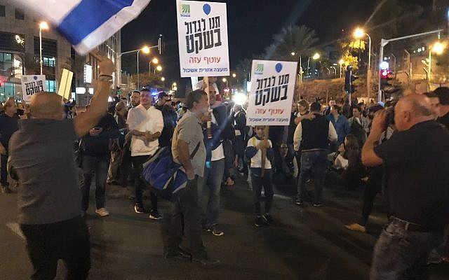 Southern residents protest in Tel Aviv over lack of security for communities in the south living under the shadow of Hamas rockets and attacks. The signs read, 'Let us grow up in peace.' (Luke Tress/The Times of Israel)