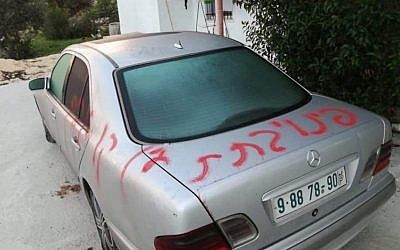 A car in the West Bank village of Jab'a spray-painted with the words 'Bat Ayin evacuation - revenge' in an apparent hate crime, November 30, 2018 (Courtesy)