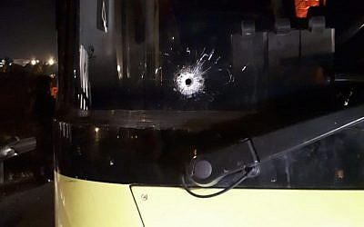 A bullethole is seen in the window of a bus that was fired upon on Route 466 in the West Bank near the settlement of Beit El on November 7, 2018. (Beit El security)
