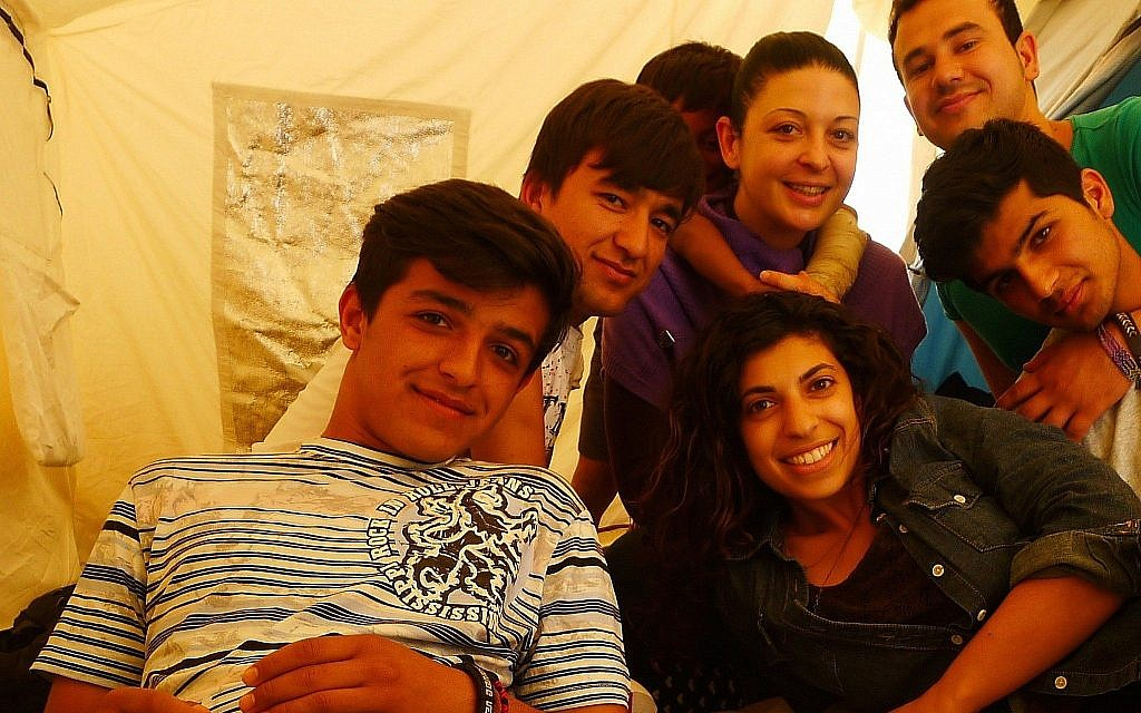 Hadas Yanay with some of the Afghan refugees she worked with in Greece before coming to HIAS. (Courtesy/ Hadas Yanay)