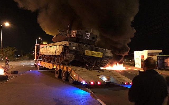 Burning tires are seen on Route 34 at the entrance to the southern Israeli town of Sderot on November 14, 2018, during a protest over the government's handling of violence from the Gaza Strip. (Israel Police)