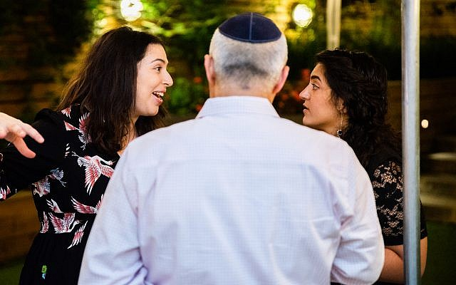 Rachel Margolin of the Musket Club, left, chatting with guests as they arrive. (Hanoch Melamed Cohen)