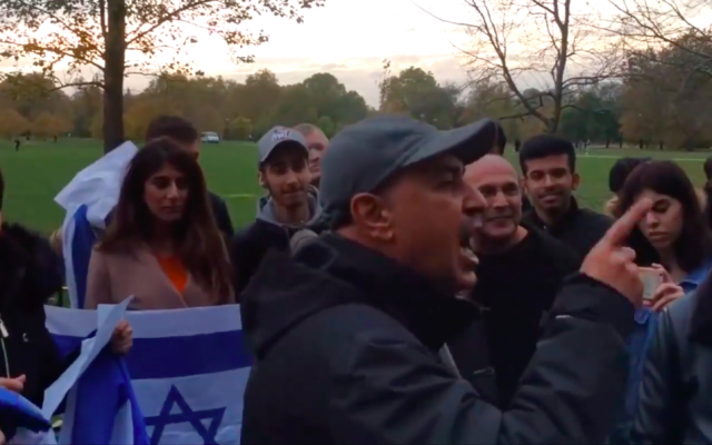 A vigil held by pro-Israel activists on Speaker's Corner in London's Hyde Park is interrupted by men shouting in Arabic on November 9, 2018. (screen capture: Israel Advocacy Movement)