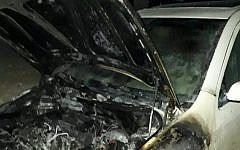 A vehicle torched in an apparent hate crime in the northern West Bank Palestinian village of Urif on November 14, 2018. (Israel Police)