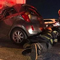 Firefighters work to free trapped passengers following crash on Route 6 on November 20, 2018. (Fire and Rescue Service)
