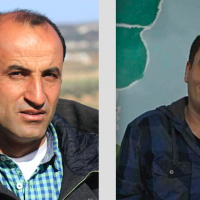This undated photo released by the Syrian anti-government activist group Kafranbl News, which has been authenticated based on its contents and other AP reporting, shows a portrait of the anti-Syrian government activist Hammoud al-Juneid,(R) and Raed Fares (L). (Kafranbl News via AP)