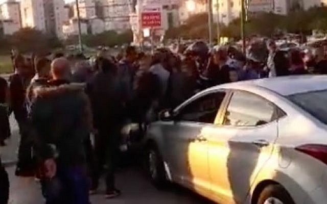 Arab-Israeli demonstrators block traffic during a protest of the demolition of a building belonging to a prominent family in their sector on November 25, 2018. (Screen capture/ Facebook)