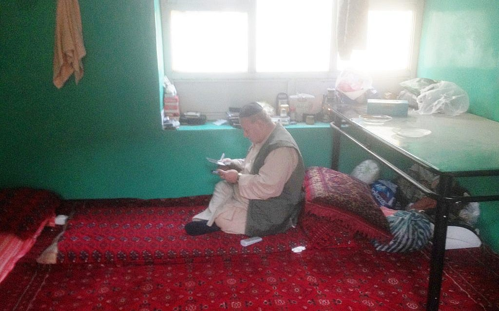 Zabolon Simantov in his room in the synagogue compound he calls home. (Ezzatullah Mehrdad/ Times of Israel)