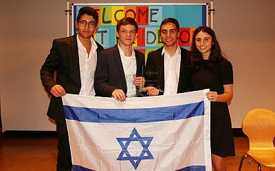 From L to R: Tamir West, Tomer Zucker Omer Zilberberg and Maya Carmon hold the Israeli flag after winning the EurOpen debate competition in Stuttgart, Germany in November 2018. (courtesy)