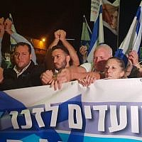 (From L-R) Likud MK Oren Hazan, Samaria Regional Council chairman Yossi Dagan, and relatives of Kim Levengrond Yehezkel and Ziv Hajbi, who were killed in a terror attack at the Barkan Industrial Zone march in their memory to the site of the attack on November 6, 2018. (Samaria Regional Council)