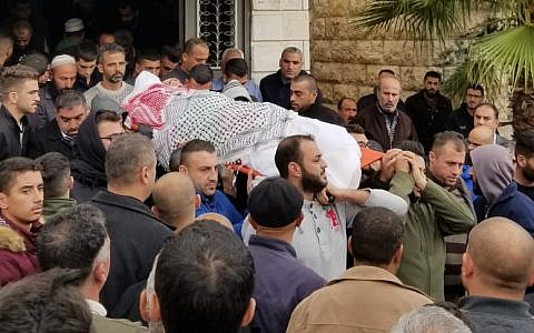 Family members carry Mahmoud Abu Asabeh's body to a burial site in Halhoul on November 14, 2018. (Adam Rasgon/ Times of Israel)