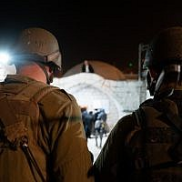 IDF soldiers watch as Jewish worshipers arrive at the Josephs Tomb holy site in the northern West Bank city of Nablus on November 7, 2018. (Israel Defense Forces)