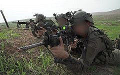 Soldiers from the IDF Commando Brigade simulate fighting the Hezbollah terror group  in northern Israel in November 2018. (Israel Defense Forces)