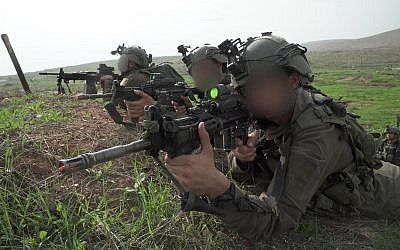 Soldiers from the IDF Commando Brigade simulate fighting the Hezbollah terror group,  in northern Israel, in November 2018. (Israel Defense Forces)
