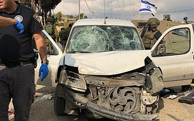 Emergency response personnel respond to an apparent car-ramming attack in which three IDF soldiers were injured in the central West Bank on November 26, 2018. (Israel Defense Forces)